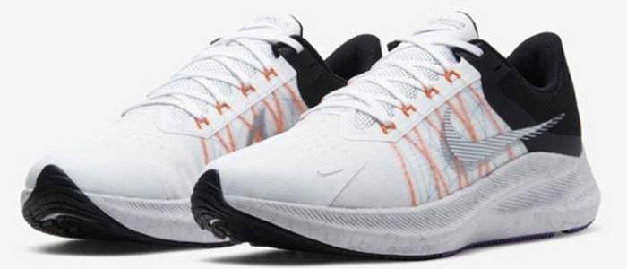 Tênis Nike Winflo 8 branco com preto e os detalhes das linhas flywire em laranja.